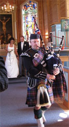 Chris playing bagpipes at wedding